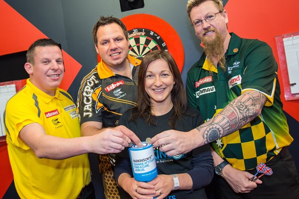 Clare Montgomery with darts players.jpg